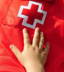 Imatge mà i logotip Creu Roja