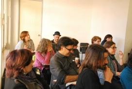 Persones assegudes en una trobada