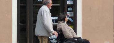 Persona amb cadira de rodes