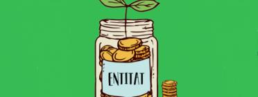 Una planta brota en un pot amb monedes