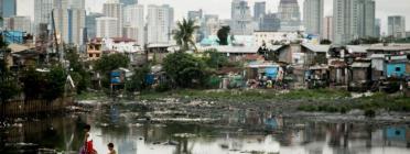 Fotografia de capçalera de l'informe: barraques a Tondo, Manila. Autor: Dewald Brand
