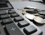 Calculadora amb monedes - Images_of_Money_ a Flickr