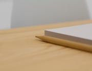 Llapis i papers a sobre d'una taula