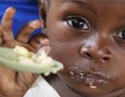 Infant menjant. Font: web Acció contra la fam