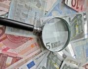 Lupa i bitllets euro d'Images_of_Money (Flickr)