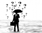 Imatge senyor amb paraigües per una pluja de preguntes. Font: Pixabay