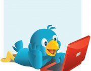 L'ocell icona de Twitter fent servir un ordinador