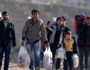 Persones fugint dels seus països. Fragment d'una fotografia del web d'AI