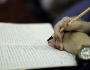 Bolígraf en mà i llibreta
