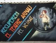 'Recuperem el Teatre Arnau'. Grafit reivindicatiu en un dels murs del barri
