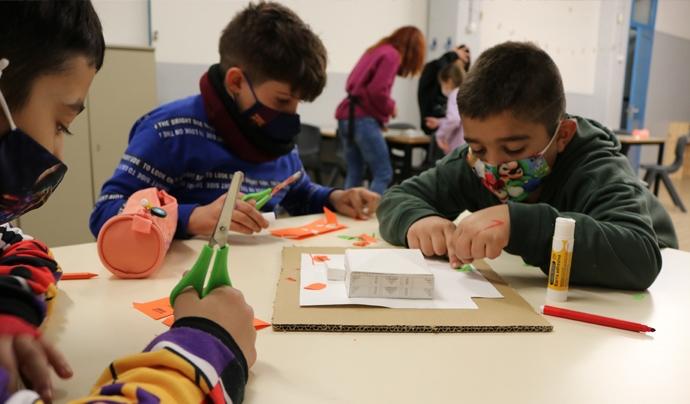 Procés participatiu de transformació i obertura del pati a la comunitat Font: Associació Casal Infantil La Mina