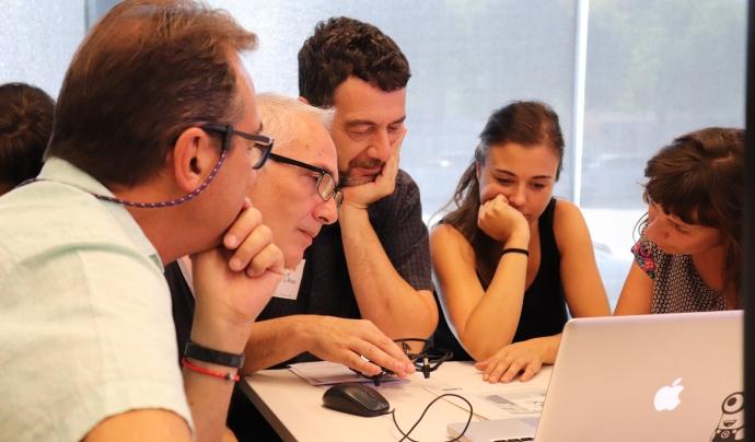 Persones participant en un dels tallers de la JdIS 2018