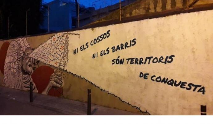 Mural amb un missatge ecofeminista a un carrer del barri de Gràcia Barcelona Font: Salvem l'Alzina i les Casetes d'Encarnació