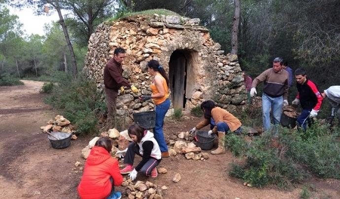 Volunatariat per la pedra seca amb l'Associació Mediambiental La Sínia Font: Associació Mediambiental La Sínia