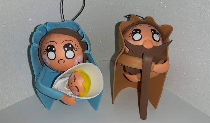 Les boles tenen forma de reis mags, angelets, Maria, el nen i Josep o animals del pessebre com el bou, el ruc i l'ovella. Font: Fundació ADIMIR. Font: Font: Fundació ADIMIR.