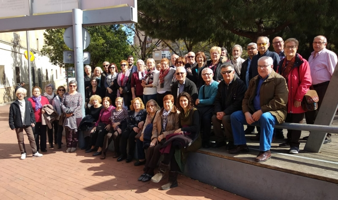 Foto de grup el dia de la inauguració d'una exposició fotogràfica Font: BlogL'Hosfera